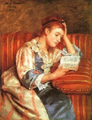 Ragazza seduta che legge